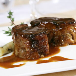 Glazed Iberian pig's trotters with grilled potatos